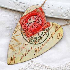 Stamped heart...love the postmark and sepia writing.  I'd like to try this on the ink jet Shrinky Dink Paper, print out vintage postcards, then cut them into hearts that could be charms, pendant or pins...