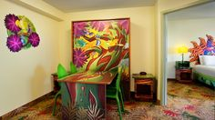 A jungle-themed table that turns into a double bed next to a bedroom with a queen bed