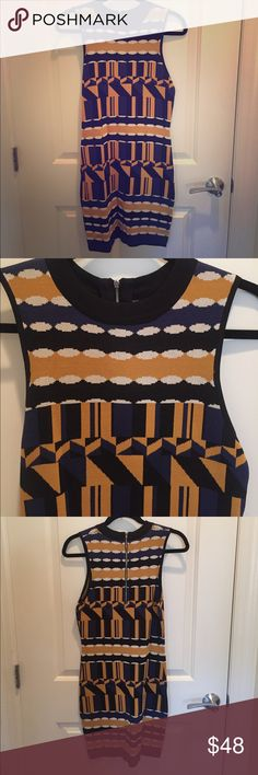 AKIRA CHICAGO Black Label Geometric Mini Size M HOT AKIRA CHICAGO exclusive Black Label mini dress black, blue, gold and white geo pattern is super flattering and fits in all the right places. Size M (fits like a 4) *CLOSET SWEEP before I move*   I wore this dress once for only a few hours! Perfect now on these cooler night and into the fall with tights and a cute leather jacket thrown over it. AKIRA Dresses Mini