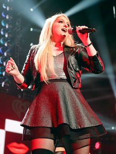 """ All About That Bass ""  Singer Meghan Trainor grabs the mic at Sunday's KISS 108 Jingle Ball in Boston."