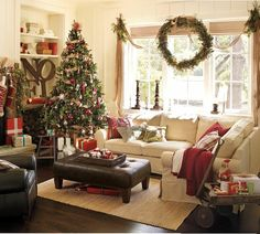 Get your holiday family room decorating on! I just bought new furniture in a lovely off-white. I can't wait to be able to change out my throw pillows and decorations to create a look like this! Makes you just want to curl up with a hot beverage and a good book and count your blessings!