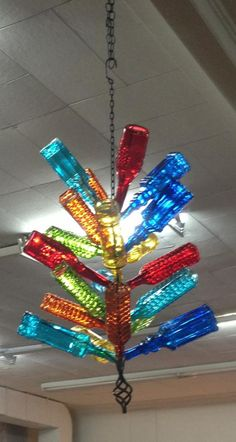 A bottle tree chandelier will be awesome on the porch! Wine Bottle Trees, Wine Bottle Art, Bottle Wall, Blue Bottle, Wine Bottle Crafts, Glass Garden Art, Bottle Garden, Glass Art, Bottles And Jars