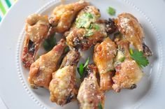 Low Carb Cheesy Garlic Wings - Keto, Gluten-Free / 1 pound chicken drumettes 1/2 cup freshly grated parmesan cheese 2 cloves garlic, very finely minced 1 tsp oregano 1/4 tsp paprika 1/2 tsp onion powder 1/2 tsp garlic powder 1/2 cup (1 stick) butter 1/2 tsp kosher salt 1/4 tsp crushed red pepper flakes 1/4 tsp freshly ground pepper 2 tbsp chopped fresh cilantro or parsley as garnish