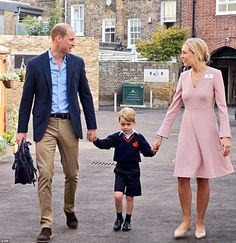 The four-year-old future king looked very smart in his new uniform, which included a blue official school jumper with red logo, blue Bermuda shorts and blue socks with laceless shoes.