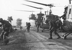 U.S. troops of the 9th Infantry Division disembark from UH-1 Iroquois helicopters during a Search and Destroy Operation against the Viet Cong in the Mekong Delta region of South Vietnam in 1969.