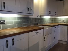 Our kitchen. Fitted ourselves. Tiled ourselves. Sage metro tiles. Oak worktops. Belfast sink.