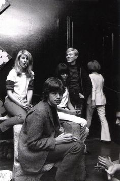 Mick Jagger at a party with Jane Holzer and Andy Warhol