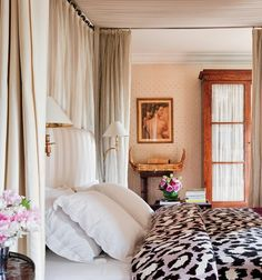 Bold bedding in a neutral room