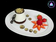 Dessert gelatin sweetened cream chocolate with crunchy hazelnuts on a bed sponge cake with chocolate and strawberries