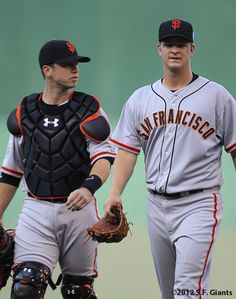 San Francisco Giants catcher Buster Posey and pitcher Matt Cain walk to the National League dugout after warming up in the bullpen at the 83rd MLB All-Star Game at Kauffman Stadium Tuesday July 10, 2012 in Kansas City, MO.../