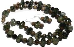 Earth colors set necklace and earrings. Prehnite, petrified wood, fossil coral, quartz.