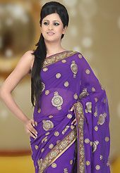 It is color this season and bright shaded suits are really something that is totally in vogue. This violet faux georgette saree have beautiful embroidery patch work which is embellished with resham, zari, sequins, stone and cutdana work. This saree gives you a modern and different look in fabulous style. Matching blouse is available. Slight Color variations are possible due to differing screen and photograph resolutions.