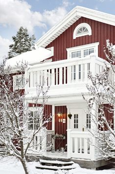 Traditional Swedish house with red walls and white windows. these swedish real estate photographs are doing one hell of a job