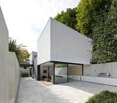 Sunken house by De Matos Ryan nestles in a secret garden.