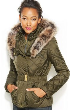 Rachel Roy RACHEL Faux-Fur-Trim Puffer Bomber Jacket   A little bit street, a lot of style: RACHEL Rachel Roy's faux fur-trimmed bomber jacket add aviator-inspired chic to any outfit.      Machine washable     Imported     Stand collar with inset placket and fake fur-trimmed hood     Hidden zipper front closure with snap-closure placket overlay     Long sleeves     Removable belt at waist; belt loops     Polyester fill     Hits at hip; approx. 24-1/2 inches long