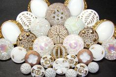 30 White Floral Vintage Czech Glass 9mm23mm Buttons by eebuttons. $47.99, via Etsy.