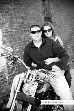 Photography by Samantha McGranahan, The Roxy Studio. Engagement, engagement photography, photography props, Harley Davidson, Motorcycle, punk, Terre Haute, sun glasses