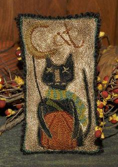cat with pumpkin - yarn punch