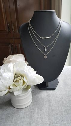All in stainless steel, this necklace will go through years with class. Swarovski pearls and rhinestone charm give it a touch of elegance. It has an extension chain. Swarovski Pearls, Pearl Necklace, Charmed, Stainless Steel, Chain, Elegant, Etsy, Jewelry, Fashion