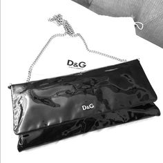 Price drop D&G Patent leather clutch Authentic D&G Sasha black patent leather envelope clutch/crossbody. Silver chain shoulder strap that is detachable (snap closures). Two interior slots plus a kiss lock coin compartment. Length 12 inches, height 6 inches, width 1.5 inches. 18 inch drop. Pre-owned in great condition with no visible scratches or damages. Kept in duster bag for few years. Dolce & Gabbana Bags Clutches & Wristlets