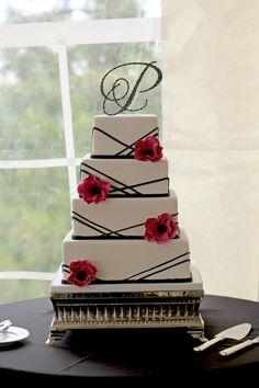 2 teers, cupcakes n blue and purple flowers instead of red