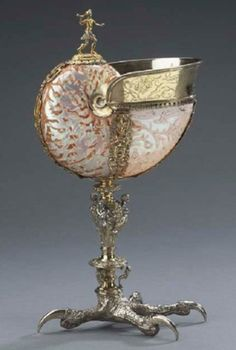 From henceforth I will only drink out of fancy ass shells! Nautilus Cup: Hunter and Eagle's Claw Foot around Goldsmith: Southern Germany Shell: China (?) nautilus shell, gilded silver x x cm The Thomson Collection © Art Gallery of Ontario Art Nouveau, Art Gallery Of Ontario, Nautilus Shell, Seashell Art, Objet D'art, Ancient Artifacts, Sea Shells, Vases, Art Decor