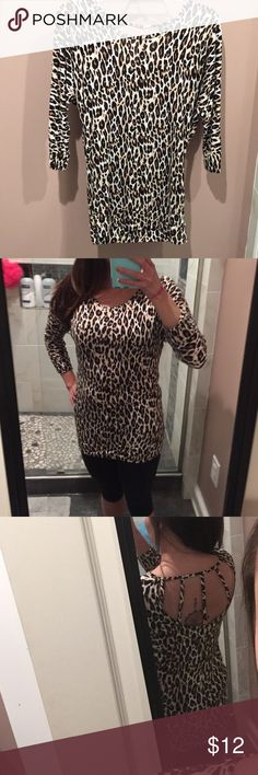 Leopard print tunic Printed tunic with caged back and a great fit! Perfect for casual days or even fun nights out, cotton material has been worn maybe twice Tops Tunics
