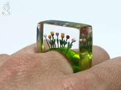 SPRING FEVER FOR THE WHOLE YEAR ROUND! A lovely, handmade unique for everyone who like it colourful. On a green ring grow ten colourful plastic mini-tulips up to the sky (red, orange, yellow, pink and white). The ring is very light and despite of the size extremely good to wear. Moreover it is a hand charmer and always an eye-catcher.  SIZE/DIMENSIONS/WEIGHT This ring will be produced suitable for you (I need about three weeks for the production). Please specify your ring size (you can…