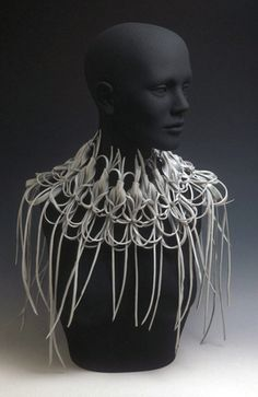 Elizabeth Staiger  Recycled Plastic Neckpiece    Found Plastic, Wire  (Would rather have seen it on a real person--but is very cool anyway)