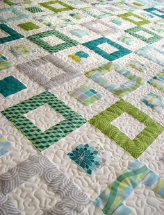"Okay, I usually zero in on piecing, but the quilting on this is REALLY cool. I love this idea of only quilting in the white/negative areas... it adds so much texture by making the colored squares ""puffy!"" I'd have been too chicken to try this without seeing someone else do it first. (And I love the colors in this quilt, too!)  QD Springtime (7) by farbstoff-bridge, via Flickr"
