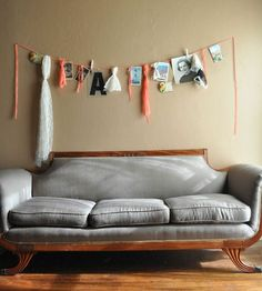 Calico skies: DIY Roundup: Home Sweet Home. Garland with pictures hung by clothes pins.
