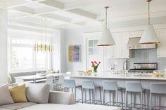 White and grey kitchen with Goodman pendants and herringbone backsplash.