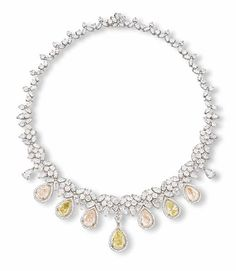 A COLOURED DIAMOND AND DIAMOND NECKLACE The front suspending seven pear-shaped yellow and light orangy brown diamonds all within a diamond surround enhanced by two smaller pear-shaped diamonds to a vari-cut diamond foliate necklace, mounted in 18k white and yellow gold, 40.0 cm long
