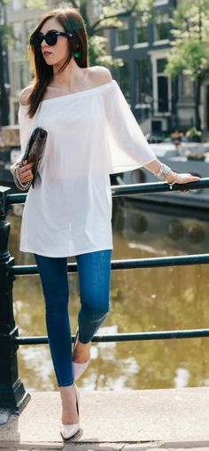 The off the shoulder trend + combine sexiness with sophistication + flowing top + endlessly more alluring + off the shoulder detailing + jeans and understated heels + Barbora Ondrackova's + gorgeous style.  Top: Asos, Jeans: Topshop, Pumps: Jimmy Choo.