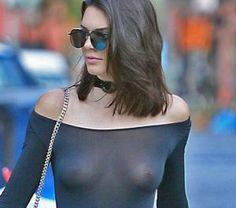 kylie jenner wearing revealing top showing nipple jewelry