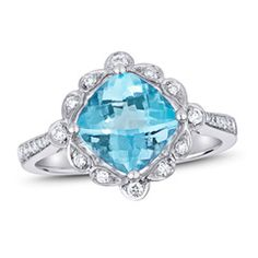 Celebrate the December birthday girl with this detailed gemstone and diamond ring. Fashioned in 14K white gold, this vintage-inspired style features an exquisite 8.0mm cushion-cut sky-blue topaz center stone wrapped in a scallop-edged frame adorned with diamonds. Additional diamonds line the ring's shank, adding superb sparkle to the look. Radiant with 1/5 ct. t.w. of diamonds and a bright polished shine, this ring is designed to delight for a lifetime.