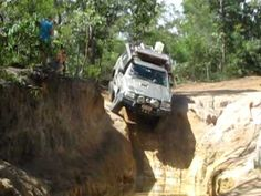 Nissan Patrol with trailer attempting Gunshot, a creek crossing on the Old Telegraph Track,  Cape York, Far North Queensland.