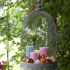 Since bird cages already come with hooks to hang, it makes them perfect outdoor decoration accent! Fill them with a candles and flowers in fun colors to instantly brighten up a corner. Boho pretty and functional!
