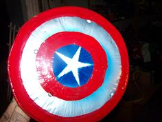 Homemade Captain America shield for our toddler. He loves it! Just an old pizza pan, a handle and strap on the back, and some spray paint. Hours of entertainment!