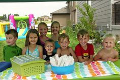 Wet n Wild Popsicle Party: party we had 14 kids, 40 popsicles, 24 bottles of water, 1 kiddie pool, 1 bounce house water slide, and 1 bubble machine, and about 250 water balloons, and a Slip n' Slide