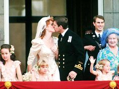 Prince Andrew and Sarah Ferguson kiss on the balcony of Buckingham Palace following their 1986 wedding at Westminster Abbey.