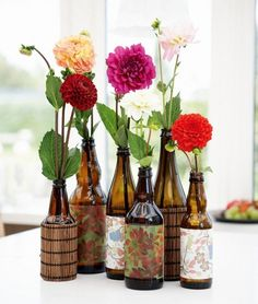 DIY vases; brown bottles with decorative paper and bamboe sheets