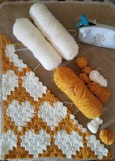 Crochet C2C hearts baby blanket.