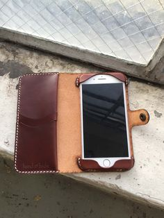 Custom Leather Phone Wallet Handmade leather iPhone 8 Plus case with white stitching. Leather Wallet Pattern, Handmade Leather Wallet, Leather Gifts, Leather Craft, Leather Working Patterns, Iphone Leather Case, Leather Accessories, Camera Accessories, Leather Jewelry