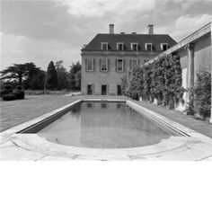 The bathing pool and magnolia wall at Middleton Park. The house was designed by Sir Edwin Lutyens and his son Robert Lutyens in 1938 for by lilly