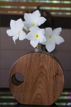 Wooden Bud Vase - This handcrafted wooden bud vase holds precious buds of your favorite flowers. Dress up the vase with a single flower for a beautiful display. Featuring a variety of hardwoods and shapes these bud vases will add the perfect finishing touch to any room in your home. The flower bud tube holds water and is inserted into the center of the wooden vase. A truly extra special gift for many occasions including Birthdays, Mother's Day, 5 Year Anniversary, or for yourself. Fresh…