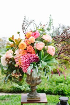 Bright eclectic floral display by Isari Flower Studio + Event Design