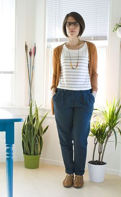Gray stripes, navy pants, mustard cardigan, simple jewelry, sensible shoes. Business Casual.