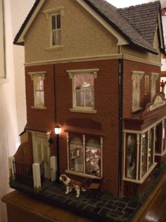 Diary of an Edwardian Dolls House. ( Revisited: Juliie Campbell's Triimbles Toy Emporium. This is my favourite shop, its crammed with minis and has loads of charm. Showing different pic of building to previous pins. Pic 1.)