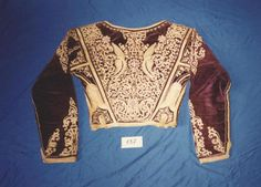 In between you find one of this Amalia Jackets that are simply divine in the embroidery. Greek Traditional Dress, Gold Embroidery, Corfu, Embroidered Jacket, Folk Costume, Rear View, Graphic Sweatshirt, Culture, Greek Costumes